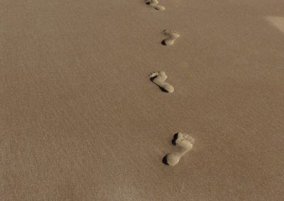 Footprints of a human being on sand at sea shore. India.